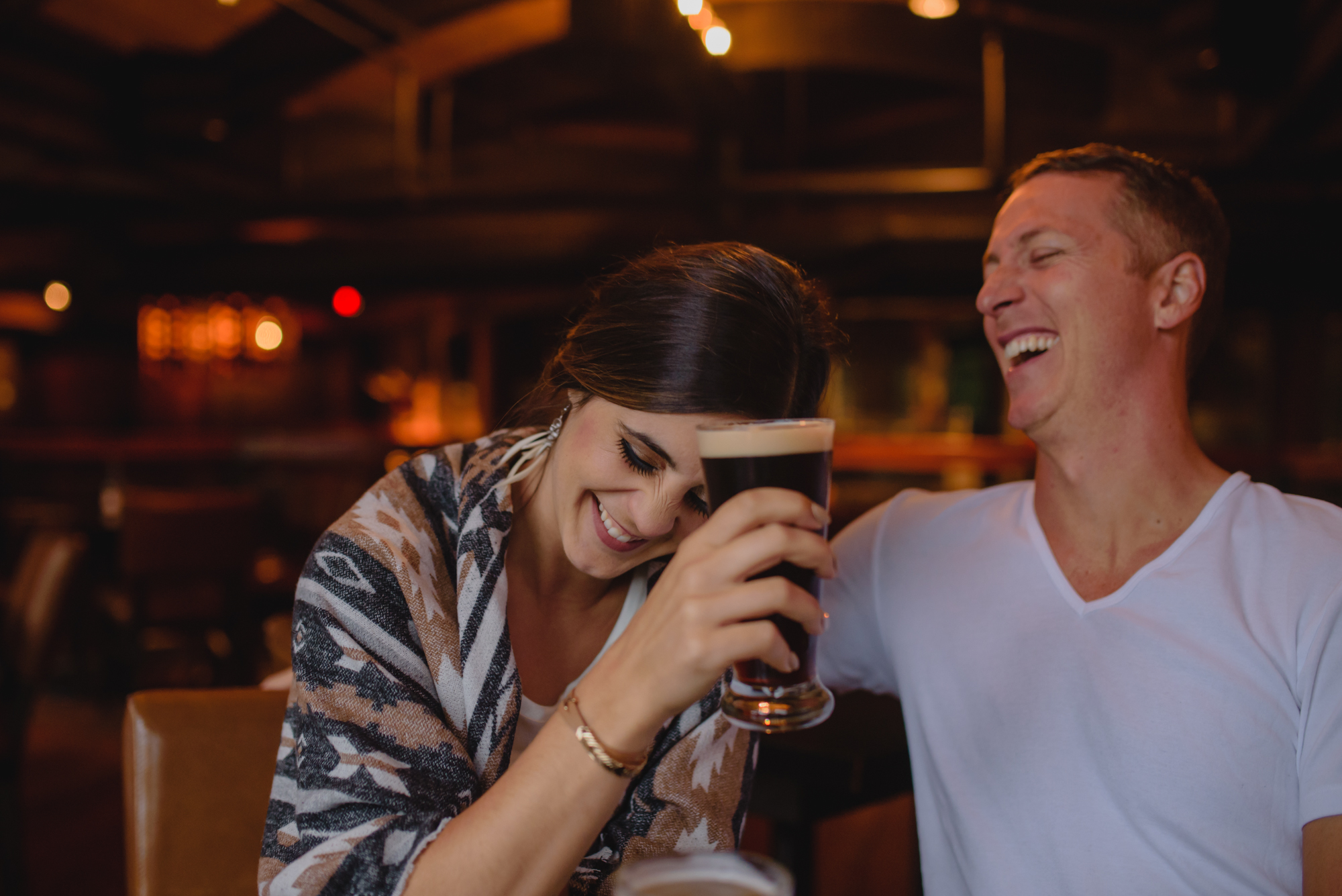 engagement photography couple drinking beer
